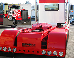 Custom rear bumpers, fenders and deck plate add a lot to a rig's looks.
